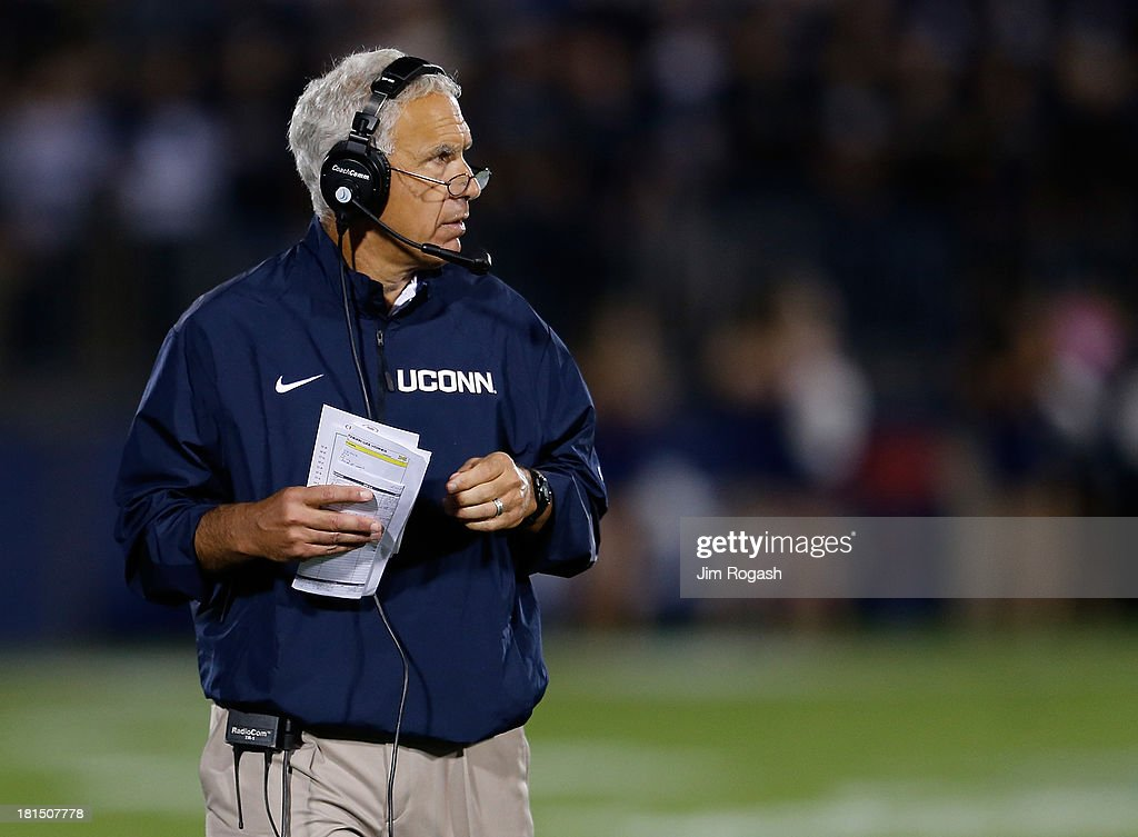Paul Pasqualoni, coach of the Connecticut Huskies, watches the action against the Michigan Wolverines at Rentschler Field on September 21, 2013 in East Hartford, Connecticut.