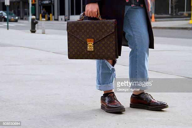 Paul Pastore seen at Skylight Clarkson Sq outside the John Elliott show wearing ripped Versace jeans Jean Paul Gaultier purple tartan coat Moschino...