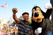 Paul 'Pauly D' DelVecchio from the hit MTV series 'Jersey Shore' 'fist pumps' with Goofy in the Magic Kingdom on October 22 2010 in Lake Buena Vista...