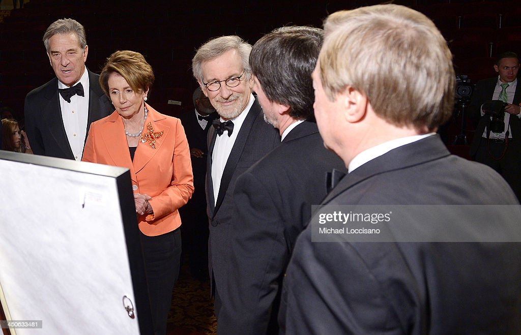 <a gi-track='captionPersonalityLinkClicked' href=/galleries/search?phrase=Paul+Pelosi&family=editorial&specificpeople=2863630 ng-click='$event.stopPropagation()'>Paul Pelosi</a>, Minority Leader of the U.S. House of Representatives <a gi-track='captionPersonalityLinkClicked' href=/galleries/search?phrase=Nancy+Pelosi&family=editorial&specificpeople=169883 ng-click='$event.stopPropagation()'>Nancy Pelosi</a>, filmmaker and honoree <a gi-track='captionPersonalityLinkClicked' href=/galleries/search?phrase=Steven+Spielberg&family=editorial&specificpeople=202022 ng-click='$event.stopPropagation()'>Steven Spielberg</a>, and Foundation for the National Archives Board Vice President and Gala Chair <a gi-track='captionPersonalityLinkClicked' href=/galleries/search?phrase=Ken+Burns&family=editorial&specificpeople=220451 ng-click='$event.stopPropagation()'>Ken Burns</a>, and Governor James Blanchard view facsimile versions of the 'two 13th Amendments' at the Foundation for the National Archives 2013 Records of Achievement award ceremony and gala in honor of <a gi-track='captionPersonalityLinkClicked' href=/galleries/search?phrase=Steven+Spielberg&family=editorial&specificpeople=202022 ng-click='$event.stopPropagation()'>Steven Spielberg</a> on November 19, 2013 in Washington, D.C.