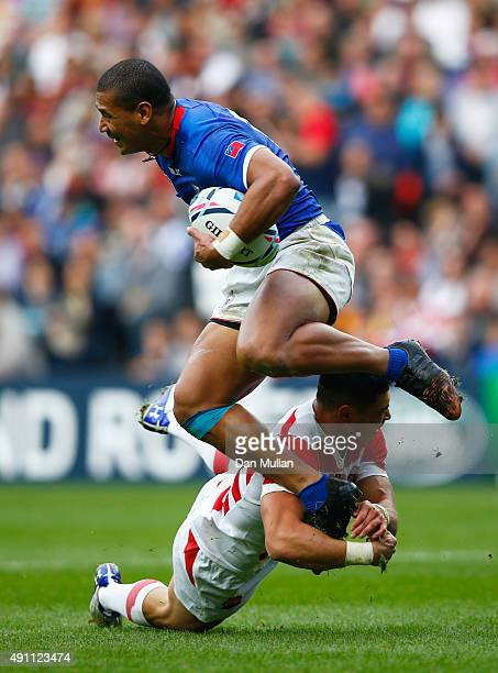 Paul Perez of Samoa is tackled by Akihito Yamada of Japan during the 2015 Rugby World Cup Pool B match between Samoa and Japan at Stadium mk on...