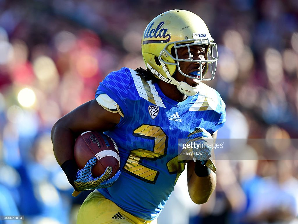 Paul Perkins #24 of the UCLA Bruins reacts to his touchdown to take a 7-3 lead over the USC Trojans during the first quarter at Los Angeles Memorial Coliseum on November 28, 2015 in Los Angeles, California.