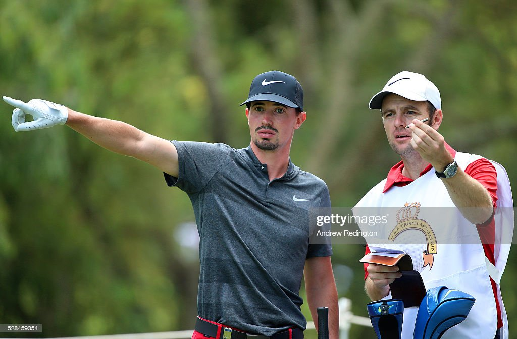 Paul Peterson of the United States speaks with his caddie Richard Logue as he prepares to hit his tee shot on the 2nd during the first round of the Trophee Hassan II at Royal Golf Dar Es Salam on May 5, 2016 in Rabat, Morocco.