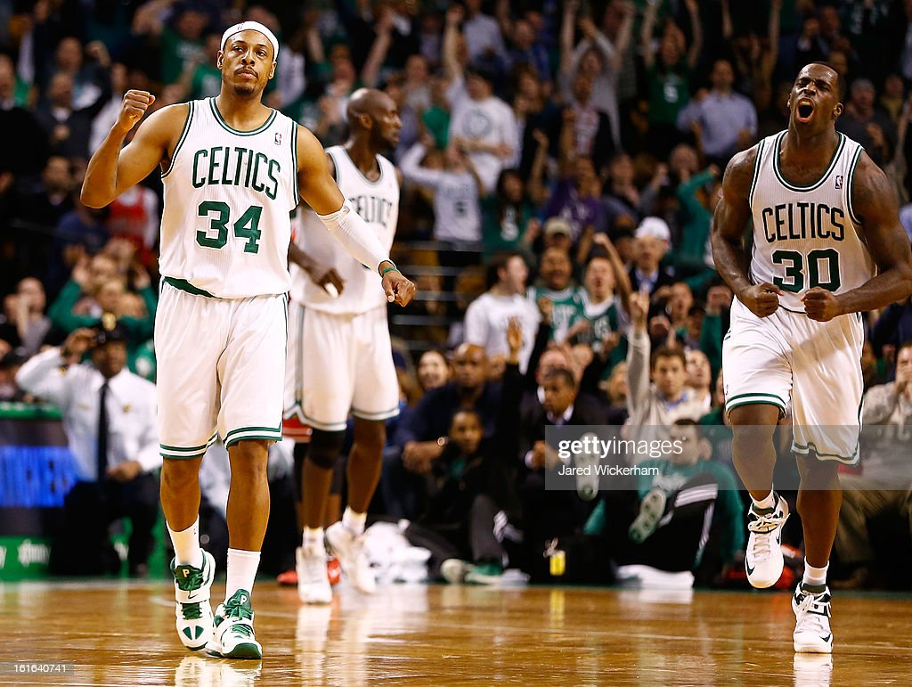Paul Pierce #34 and Brandon Bass #30 of the Boston Celtics celebrate following Pierce's basket in the fourth quarter against the Chicago Bulls during the game on February 13, 2013 at TD Garden in Boston, Massachusetts.