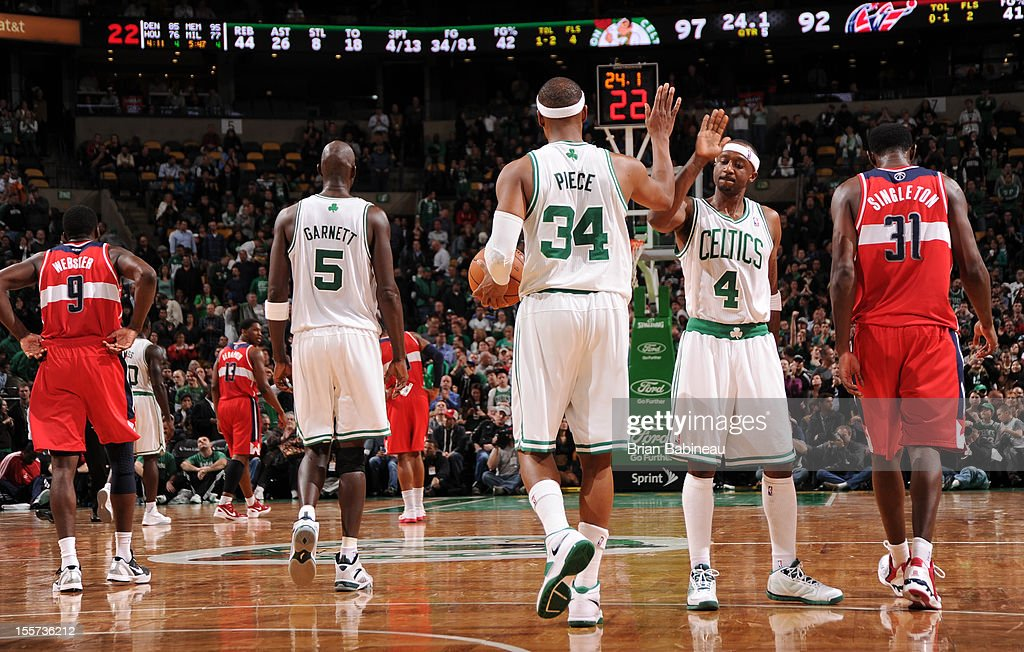 Paul Pierce #34 and Jason Terry #4 of the Boston Celtics give eachother a high five against the Washington Wizards on November 7, 2012 at the TD Garden in Boston, Massachusetts.