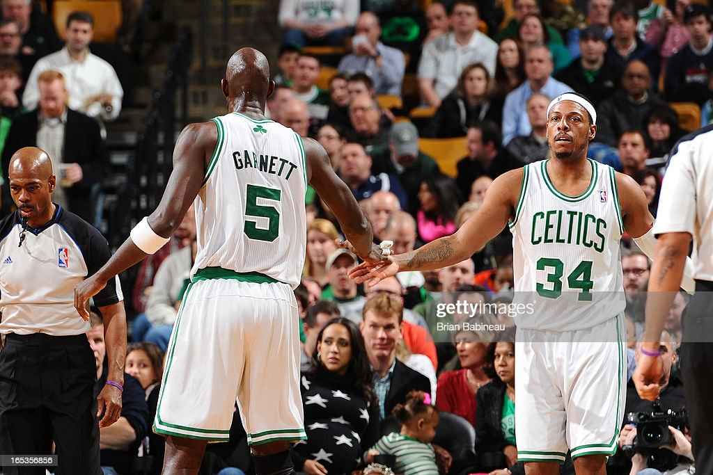 Paul Pierce #34 and Kevin Garnett #5 of the Boston Celtics celebrate a shot against the Atlanta Hawks on March 8, 2013 at the TD Garden in Boston, Massachusetts.