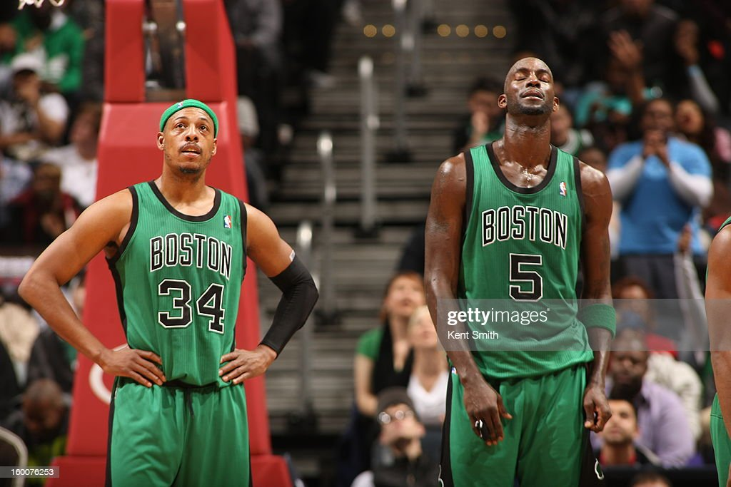 Paul Pierce #34 and Kevin Garnett #5 of the Boston Celtics look on during the overtime period against the Atlanta Hawks at the Philips Arena on January 25, 2013 in Atlanta, Georgia.