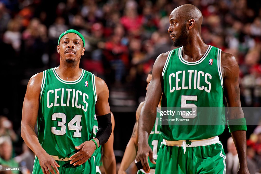 Paul Pierce #34 and Kevin Garnett #5 of the Boston Celtics wait to resume action against the Portland Trail Blazers on February 24, 2013 at the Rose Garden Arena in Portland, Oregon.