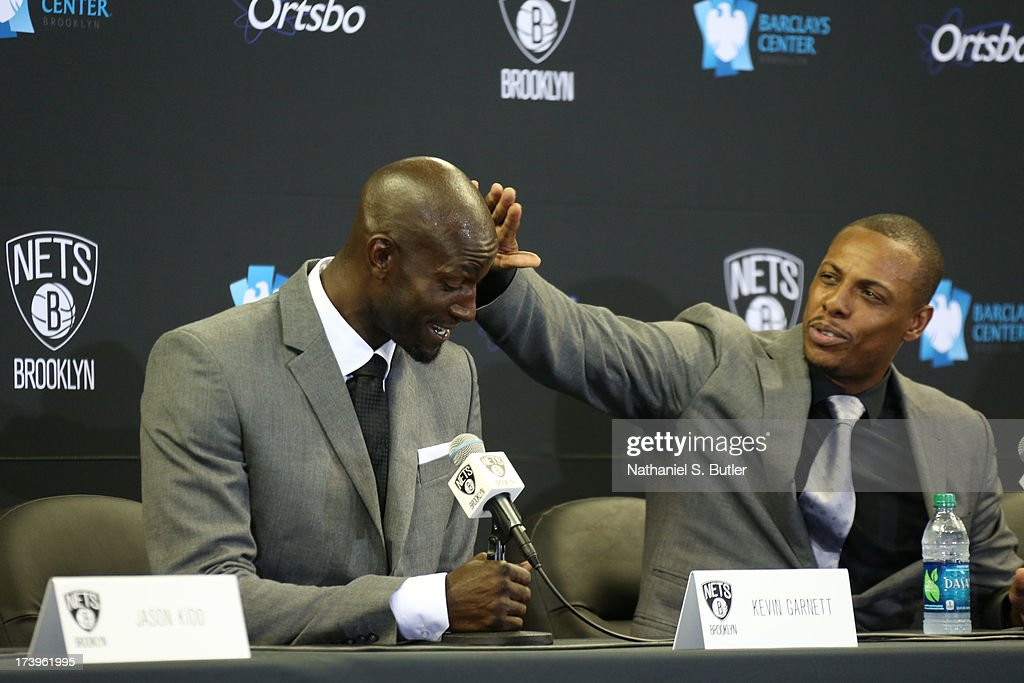 Paul Pierce #34 and Kevin Garnett #2 of the Brooklyn Nets interact during a press conference at the Barclays Center on July 18, 2013 in the Brooklyn borough of New York City.
