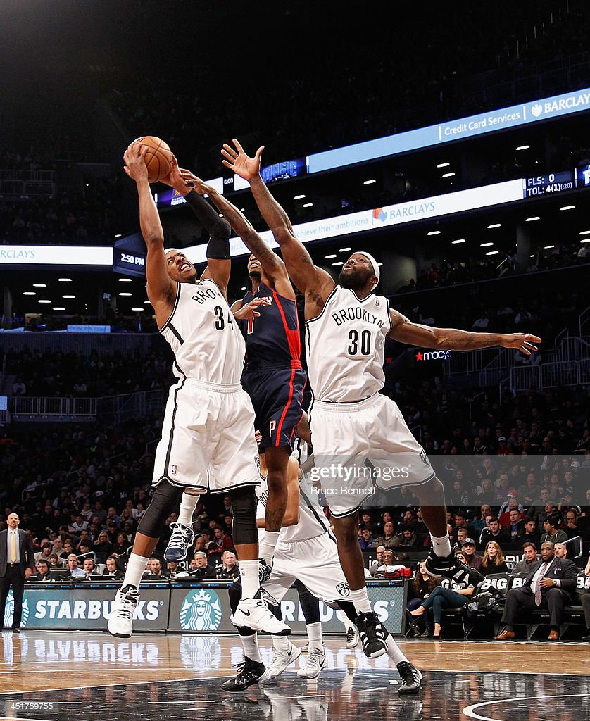 Paul Pierce #34 and Reggie Evans #30 of the Brooklyn Nets combine to grab a rebound away from Chauncey Billups #1 of the Detroit Pistons at the Barclays Center on November 24, 2013 in the Brooklyn borough of New York City.