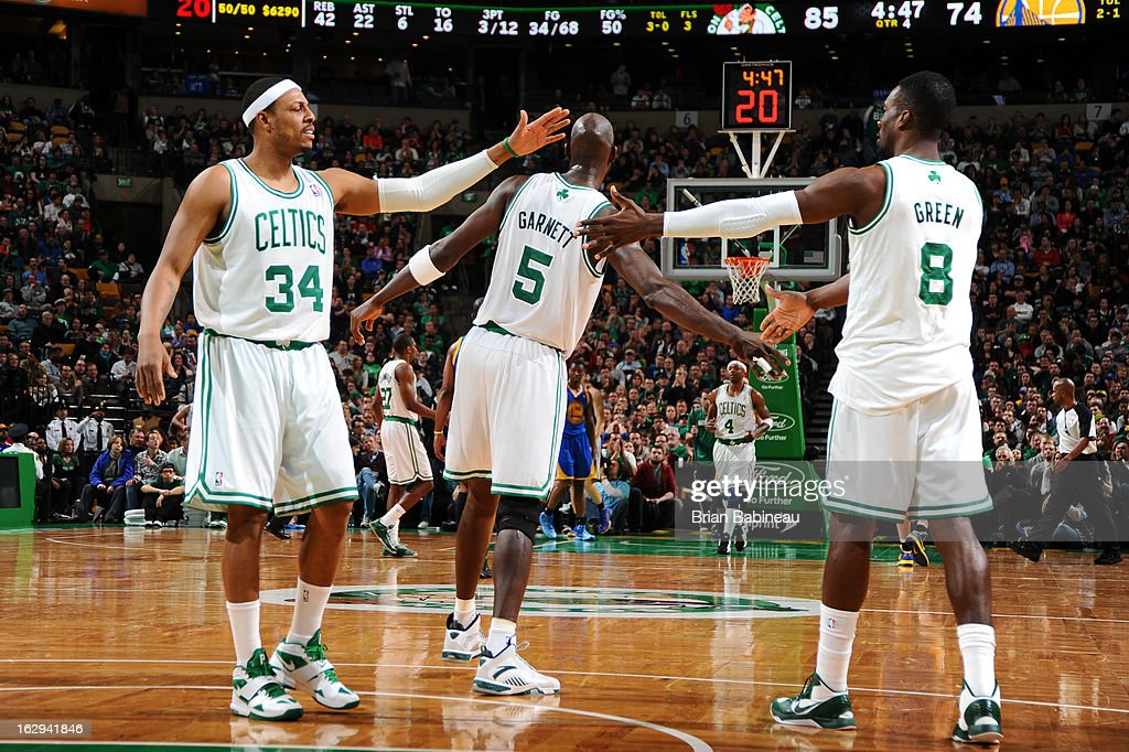 Paul Pierce #34, Kevin Garnett #5 and Jeff Green #8 of the Boston Celtics high five each other after a play against the Golden State Warriors on March 1, 2013 at the TD Garden in Boston, Massachusetts.
