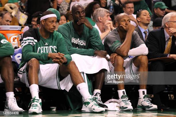 Paul Pierce Kevin Garnett and Ray Allen of the Boston Celtics look on dejected from the bench in the fourth quarter against the Miami Heat in Game...