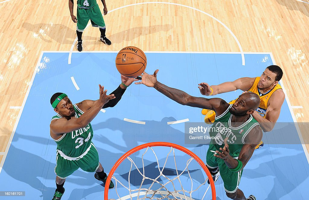 Paul Pierce #34 of the Boston Celtics and Kevin Garnett #5 of the Boston Celtics go up for a rebound against the Denver Nuggets on February 19, 2013 at the Pepsi Center in Denver, Colorado.