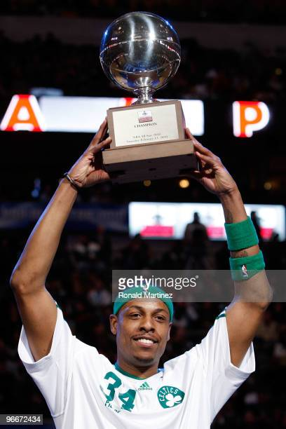 Paul Pierce of the Boston Celtics celebrates with the Champions Trophy after winning the Foot Locker Three Point Shootout on AllStar Saturday Night...