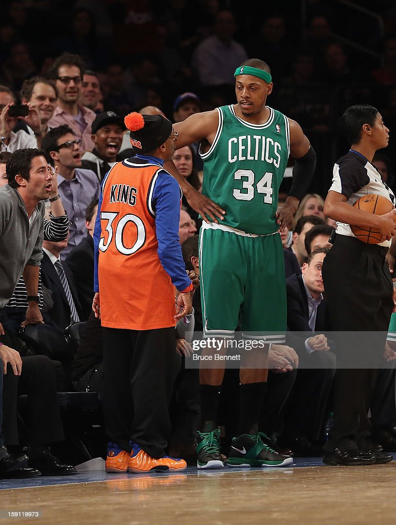 Paul Pierce #34 of the Boston Celtics chats with director Spike Lee during the game against the New York Knicks at Madison Square Garden on January 7, 2013 in New York City.