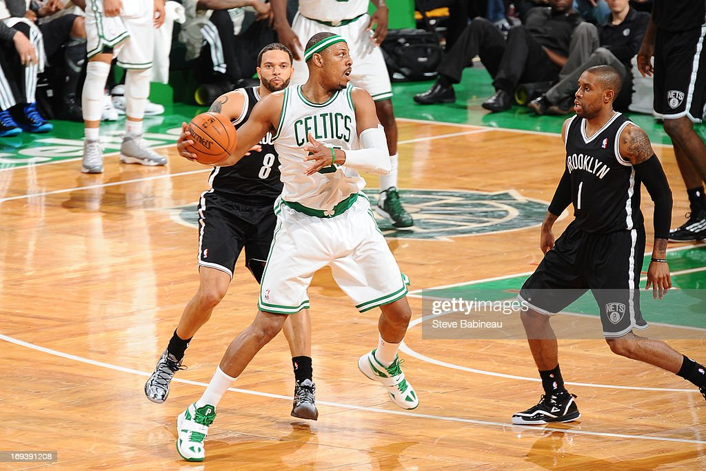 <a gi-track='captionPersonalityLinkClicked' href=/galleries/search?phrase=Paul+Pierce&family=editorial&specificpeople=201562 ng-click='$event.stopPropagation()'>Paul Pierce</a> #34 of the Boston Celtics controls the ball against <a gi-track='captionPersonalityLinkClicked' href=/galleries/search?phrase=Deron+Williams&family=editorial&specificpeople=203215 ng-click='$event.stopPropagation()'>Deron Williams</a> #8 and <a gi-track='captionPersonalityLinkClicked' href=/galleries/search?phrase=C.J.+Watson&family=editorial&specificpeople=740190 ng-click='$event.stopPropagation()'>C.J. Watson</a> #1 of the Brooklyn Nets on April 10, 2013 at the TD Garden in Boston, Massachusetts.