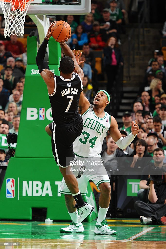 Paul Pierce #34 of the Boston Celtics defends against Joe Johnson #7 of the Brooklyn Nets on April 10, 2013 at the TD Garden in Boston, Massachusetts.