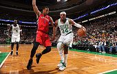 Paul Pierce of the Boston Celtics dribbles the ball while guarded by Dominic McGuire of the Toronto Raptors on November 17 2012 at the TD Garden in...