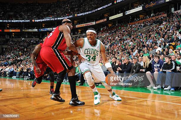 Paul Pierce of the Boston Celtics drives against Erick Dampier of the Miami Heat on February 13 2011 at the TD Garden in Boston Massachusetts NOTE TO...
