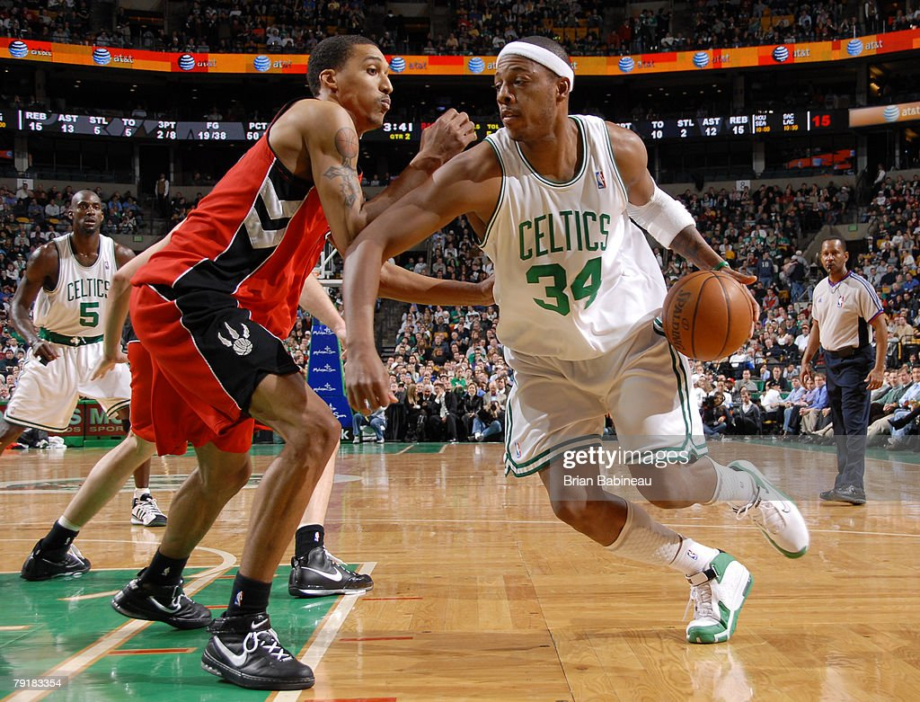 Paul Pierce #34 of the Boston Celtics drives against Jamario Moon #33 of the Toronto Raptors on January 23, 2008 at the TD Banknorth Garden in Boston, Massachusetts.