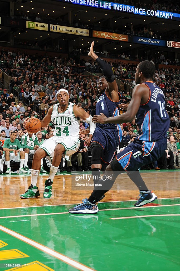 Paul Pierce #34 of the Boston Celtics drives against Jeff Adrien #4 and Michael Kidd-Gilchrist #14 of the Charlotte Bobcats on January 14, 2013 at the TD Garden in Boston, Massachusetts.