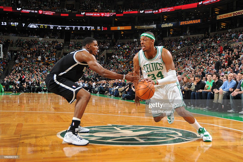 <a gi-track='captionPersonalityLinkClicked' href=/galleries/search?phrase=Paul+Pierce&family=editorial&specificpeople=201562 ng-click='$event.stopPropagation()'>Paul Pierce</a> #34 of the Boston Celtics drives against <a gi-track='captionPersonalityLinkClicked' href=/galleries/search?phrase=Joe+Johnson+-+Basketball+Player&family=editorial&specificpeople=201652 ng-click='$event.stopPropagation()'>Joe Johnson</a> #7 of the Brooklyn Nets on April 10, 2013 at the TD Garden in Boston, Massachusetts.