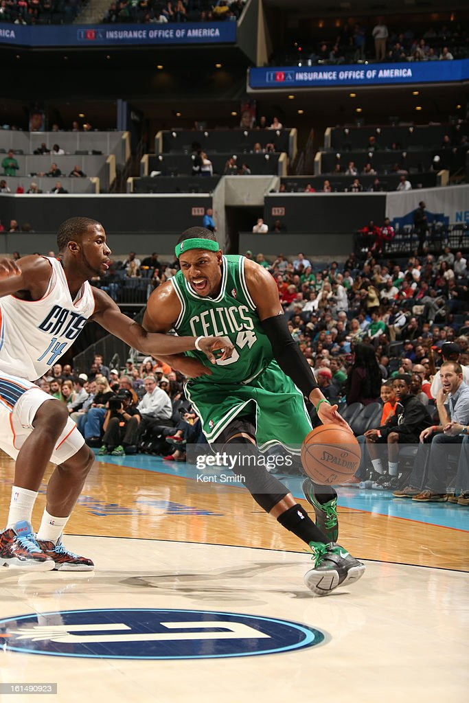 Paul Pierce #34 of the Boston Celtics drives against Michael Kidd-Gilchrist #14 of the Charlotte Bobcats at the Time Warner Cable Arena on February 11, 2013 in Charlotte, North Carolina.
