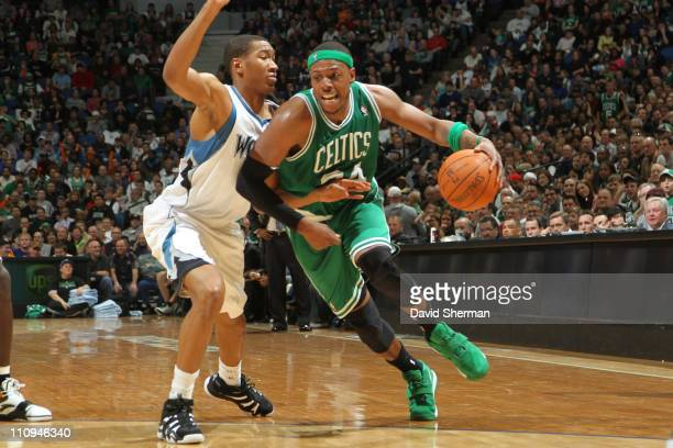 Paul Pierce of the Boston Celtics drives against Wesley Johnson of the Minnesota Timberwolves on March 27 2011 at Target Center in Minneapolis...