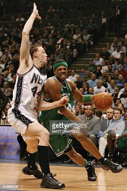 Paul Pierce of the Boston Celtics drives past Keith Van Horn of the New Jersey Nets during game two of their NBA Eastern Conference finals 21 May...