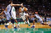 Paul Pierce of the Boston Celtics drives to the basket past Tony Allen of the Memphis Grizzlies during the game on January 2 2013 at TD Garden in...