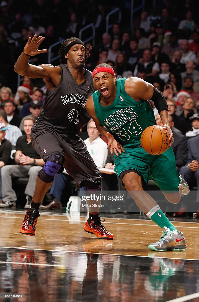 Paul Pierce #34 of the Boston Celtics drives to the net against Gerald Wallace #45 of the Brooklyn Nets at the Barclays Center on December 25, 2012 in the Brooklyn borough of New York City.