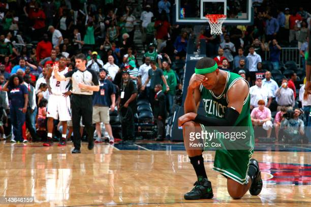 Paul Pierce of the Boston Celtics drops to one knee after their 8780 win over the Atlanta Hawks in Game Two of the Eastern Conference Quarterfinals...