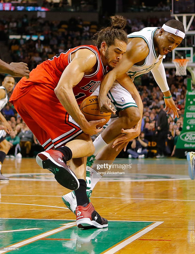 Paul Pierce #34 of the Boston Celtics fights for a loose ball with Joakim Noah #13 of the Chicago Bulls during the game on February 13, 2013 at TD Garden in Boston, Massachusetts.