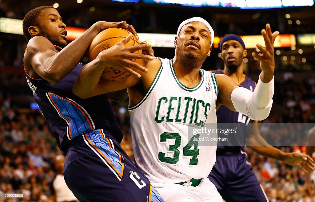 Paul Pierce #34 of the Boston Celtics fights for possession of the ball against Michael Kidd-Gilchrist #14 of the Charlotte Bobcats during the game on January 14, 2013 at TD Garden in Boston, Massachusetts.