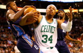Paul Pierce of the Boston Celtics fights for possession of the ball against Michael KiddGilchrist of the Charlotte Bobcats during the game on January...