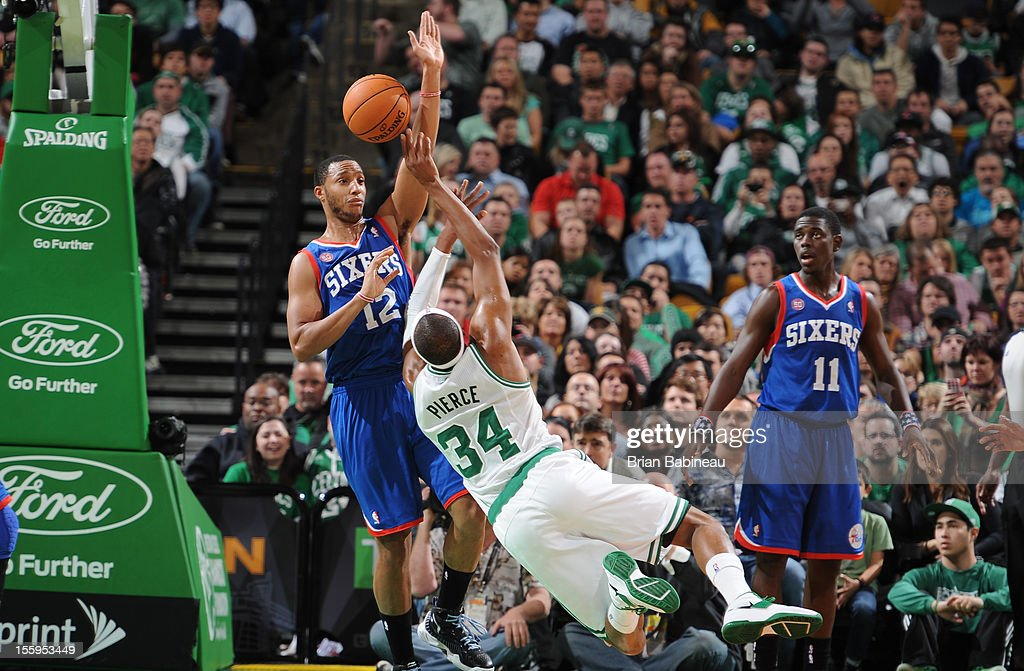 Paul Pierce #34 of the Boston Celtics gets fouled against Evan Turner #12 of the Philadelphia 76ers on November 9, 2012 at the TD Garden in Boston, Massachusetts.