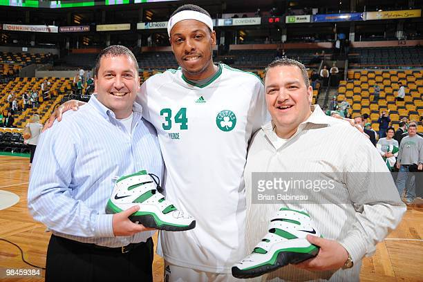 Paul Pierce of the Boston Celtics gives his game shoes to lucky fans after the game against the Milwaukee Bucks on April 14 2010 at the TD Garden in...
