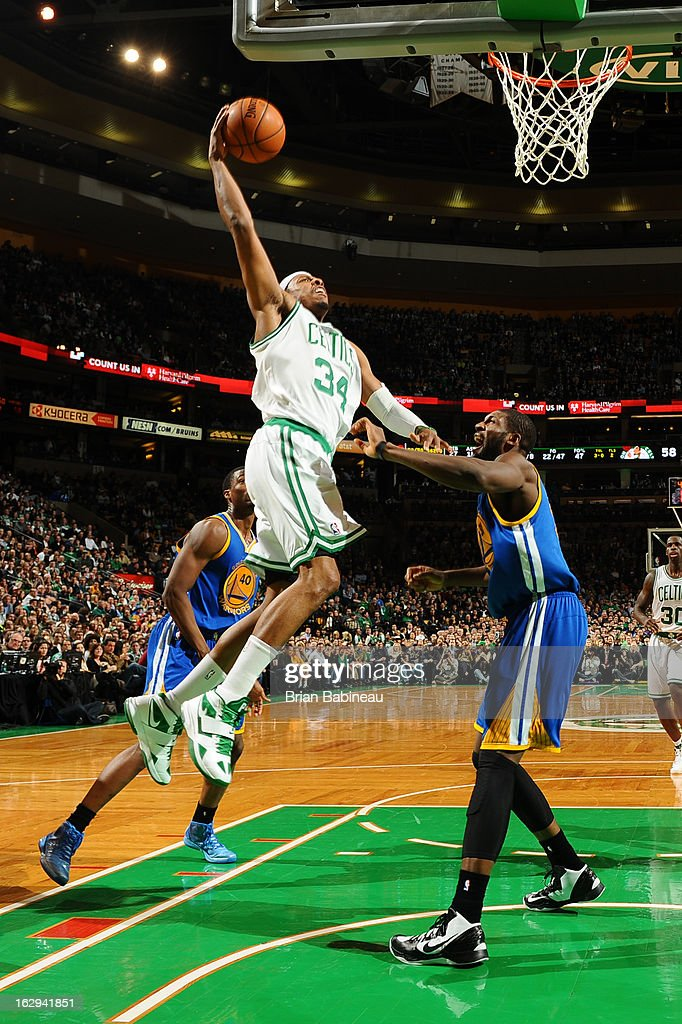 Paul Pierce #34 of the Boston Celtics goes in for a dunk against Festus Ezeli #31 of the Golden State Warriors on March 1, 2013 at the TD Garden in Boston, Massachusetts.