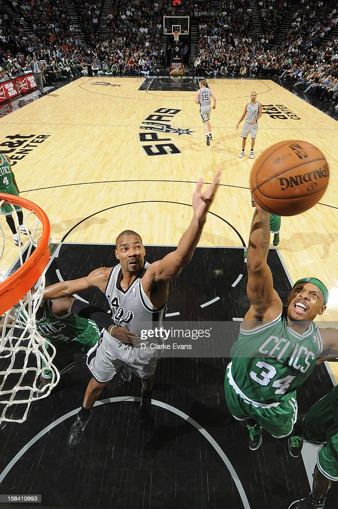 <a gi-track='captionPersonalityLinkClicked' href=/galleries/search?phrase=Paul+Pierce&family=editorial&specificpeople=201562 ng-click='$event.stopPropagation()'>Paul Pierce</a> #34 of the Boston Celtics goes to the basket against <a gi-track='captionPersonalityLinkClicked' href=/galleries/search?phrase=Gary+Neal&family=editorial&specificpeople=5085165 ng-click='$event.stopPropagation()'>Gary Neal</a> #14 of the San Antonio Spurs during the game between the Boston Celtics and the San Antonio Spurs on December 15, 2012 at the AT&T Center in San Antonio, Texas.