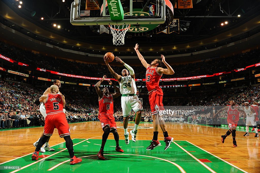 Paul Pierce #34 of the Boston Celtics goes to the basket against Luol Deng #9 and Joakim Noah #13 of the Chicago Bulls on February 13, 2013 at the TD Garden in Boston, Massachusetts.