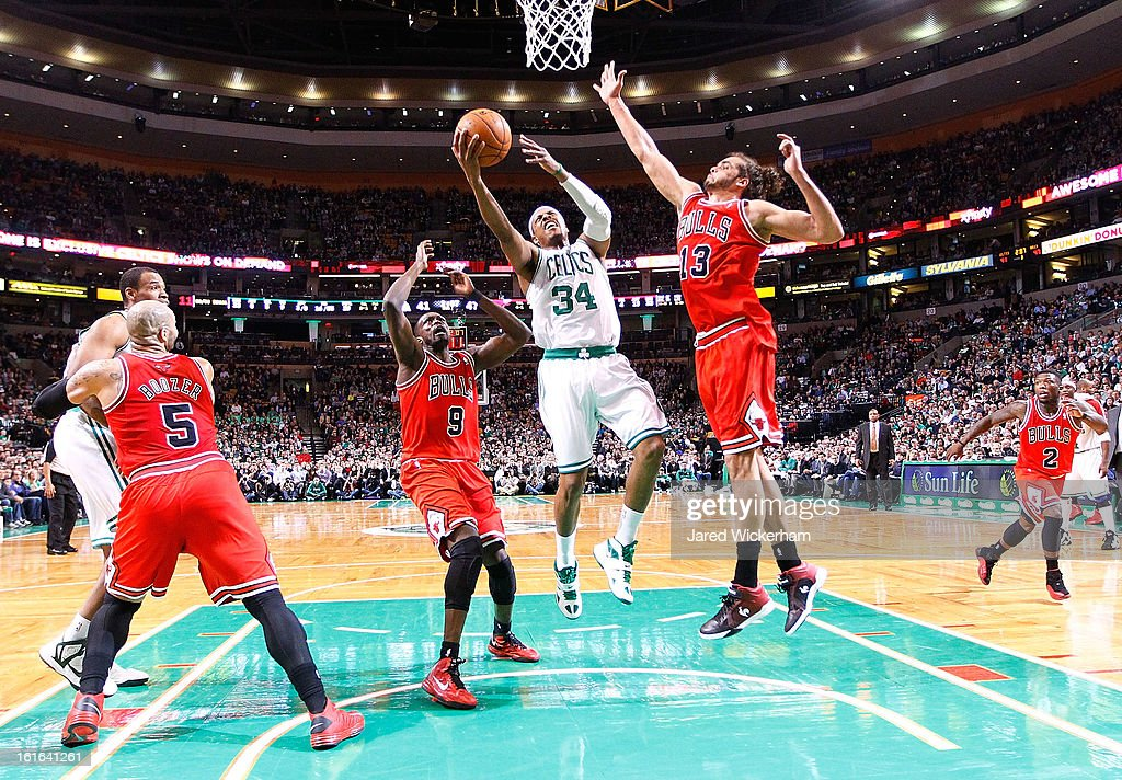 Paul Pierce #34 of the Boston Celtics goes up for a layup in front of Joakim Noah #13 of the Chicago Bulls during the game on February 13, 2013 at TD Garden in Boston, Massachusetts.