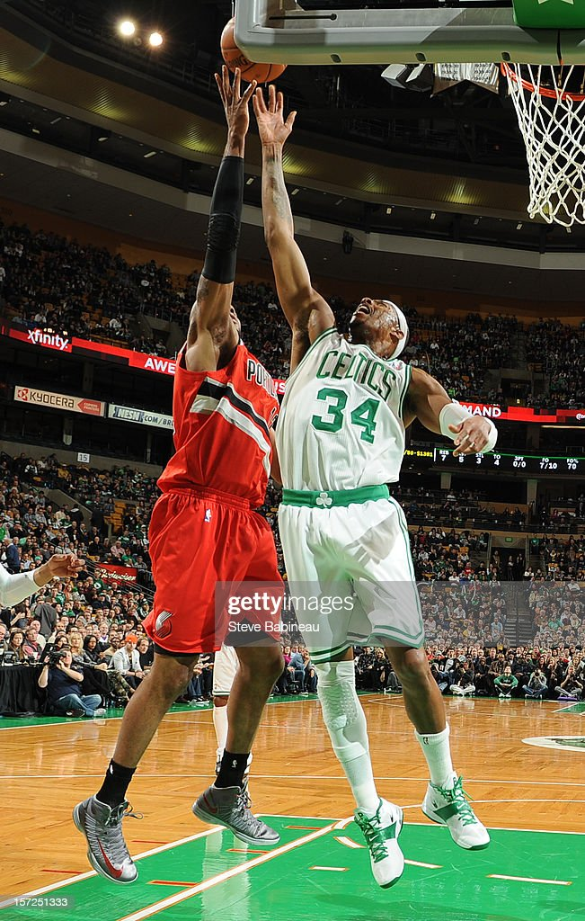 Paul Pierce #34 of the Boston Celtics goes up for a rebound against LaMarcus Aldridge #12 of the Portland Trail Blazers on November 30, 2012 at the TD Garden in Boston, Massachusetts.