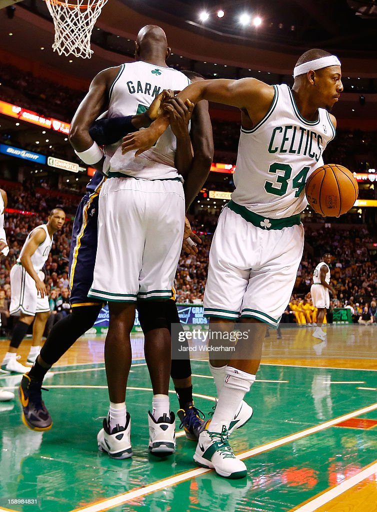 Paul Pierce #34 of the Boston Celtics has his arm grabbed from behind the body of teammate Kevin Garnett #5 of the Boston Celtics after coming up with an offensive rebound against the Indiana Pacers during the game on January 4, 2013 at TD Garden in Boston, Massachusetts.