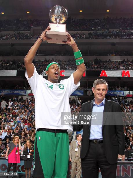 Paul Pierce of the Boston Celtics hoists his trophy after winning the Foot Locker Three Point Contest on AllStar Saturday Night as part of the 2010...
