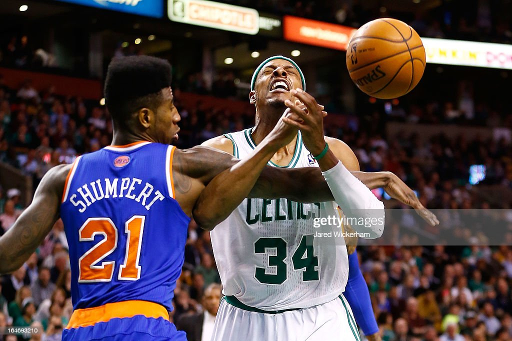 Paul Pierce #34 of the Boston Celtics is fouled by Iman Shumpert #21 of the New York Knicks during the game on March 26, 2013 at TD Garden in Boston, Massachusetts.