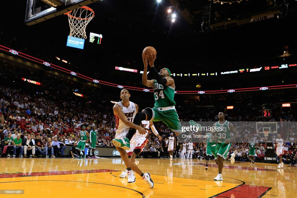 Paul Pierce #34 of the Boston Celtics lays the ball up past Shane Battier #31 of the Miami Heat at American Airlines Arena on October 30, 2012 in Miami, Florida.