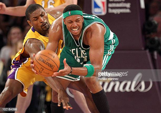 Paul Pierce of the Boston Celtics looks to move the ball as he is covered by Ron Artest of the Los Angeles Lakers in the first quarter of Game Seven...