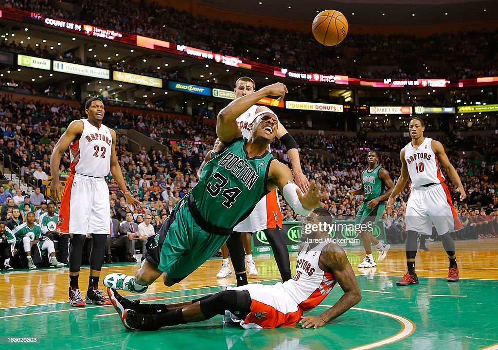 Paul Pierce #34 of the Boston Celtics loses the ball after colliding with Amir Johnson #15 of the Toronto Raptors during the game on March 13, 2013 at TD Garden in Boston, Massachusetts.