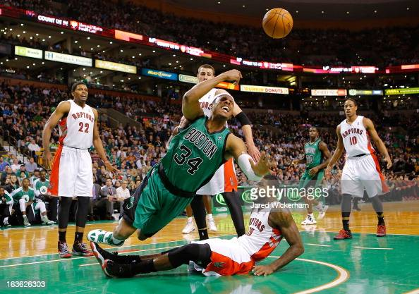 Paul Pierce of the Boston Celtics loses the ball after colliding with Amir Johnson of the Toronto Raptors during the game on March 13 2013 at TD...