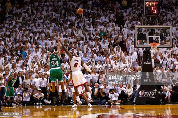 Paul Pierce of the Boston Celtics makes a 3point basket in the final minute of the fourth quarter against LeBron James of the Miami Heat in Game Five...